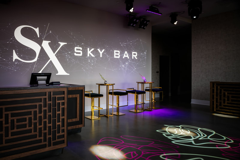 SX Sky bar logo projected on entry area