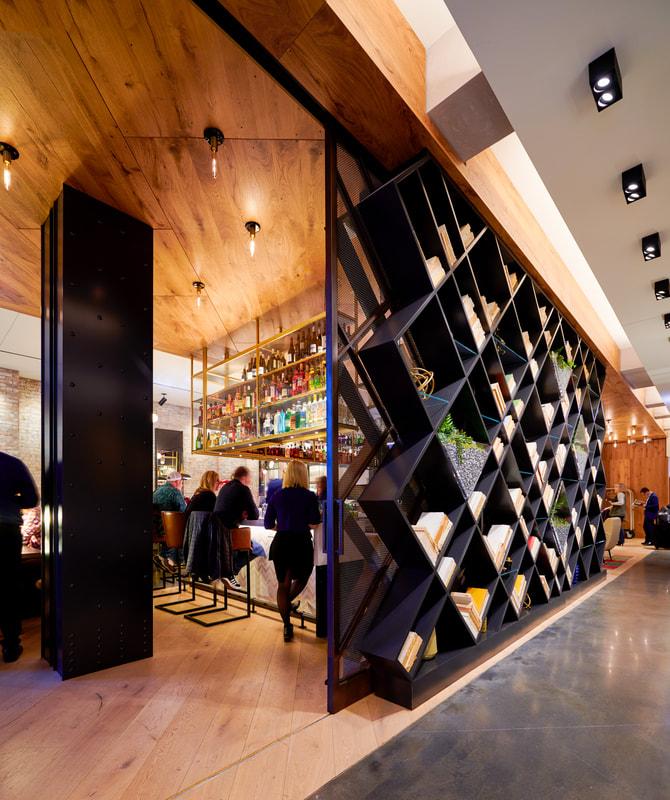 Hotel Julian bar and bookshelf area