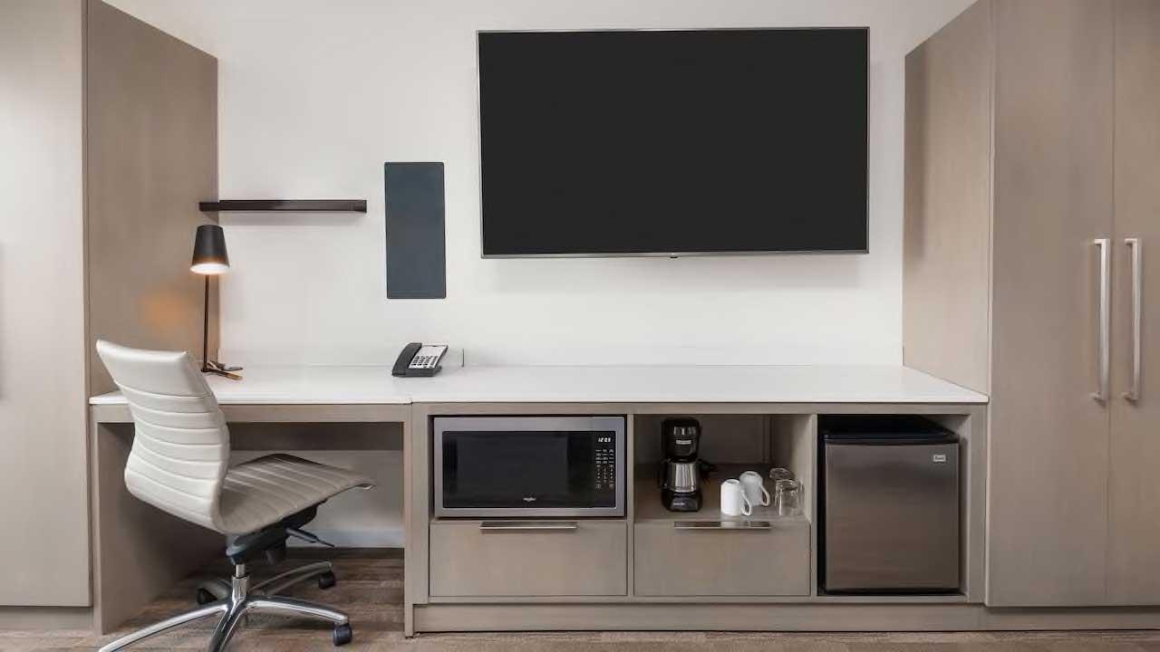 Hyatt House guest desk, closet and entertainment space