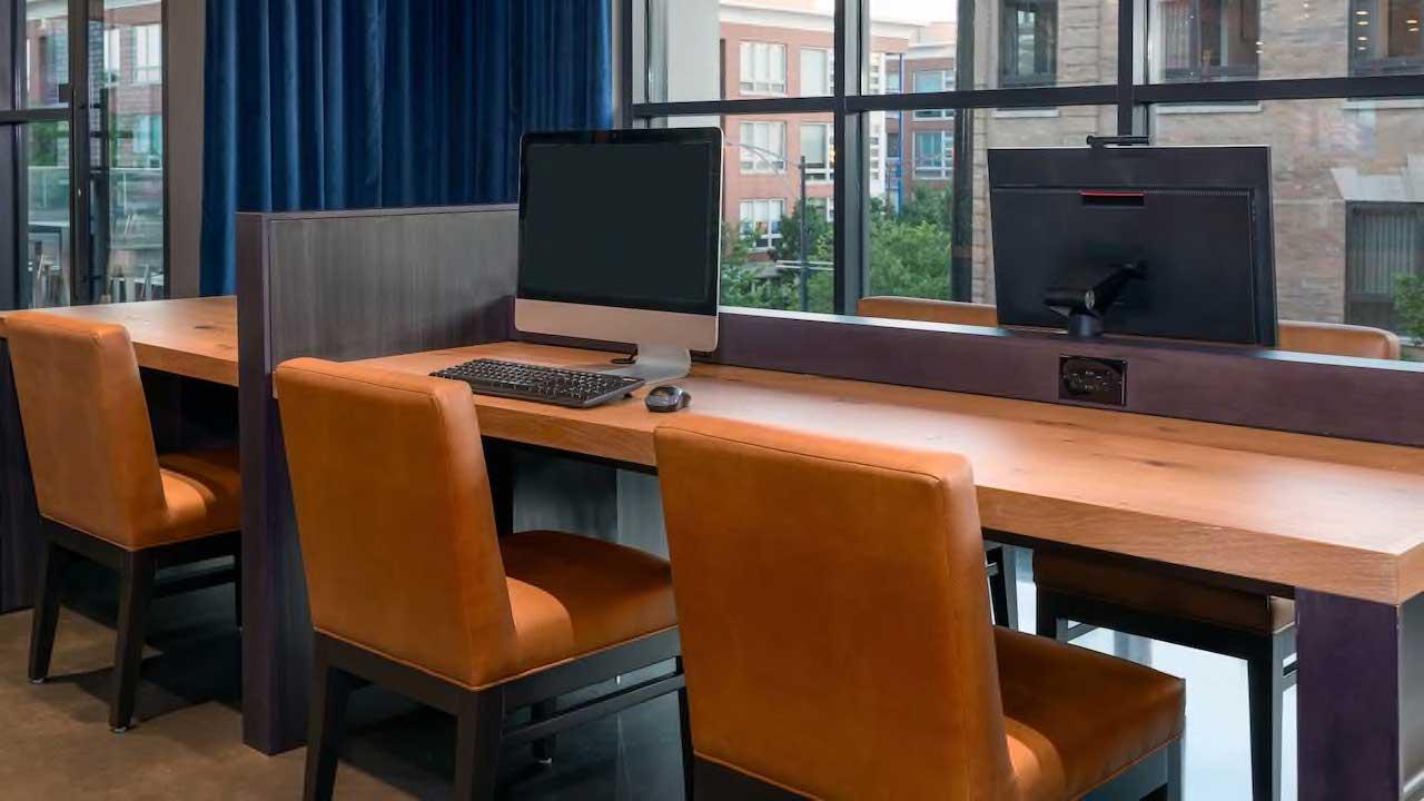 Hyatt House business center computers and desks