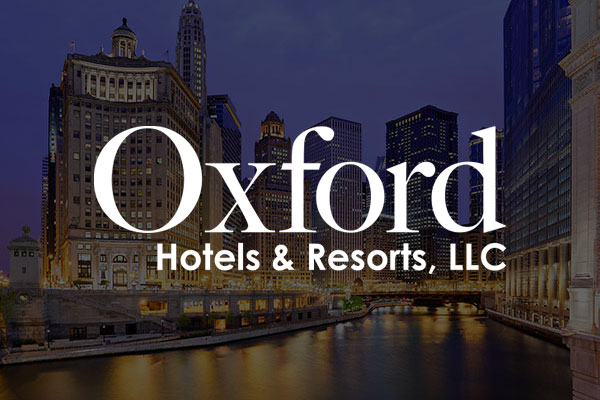 The Oxford Hotels & Resorts logo appears overtop an image of a city skyline at night