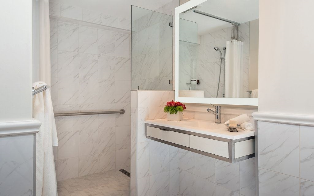 White marble-tiled bathroom