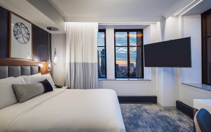 Luxury hotel room with window views of the skyline
