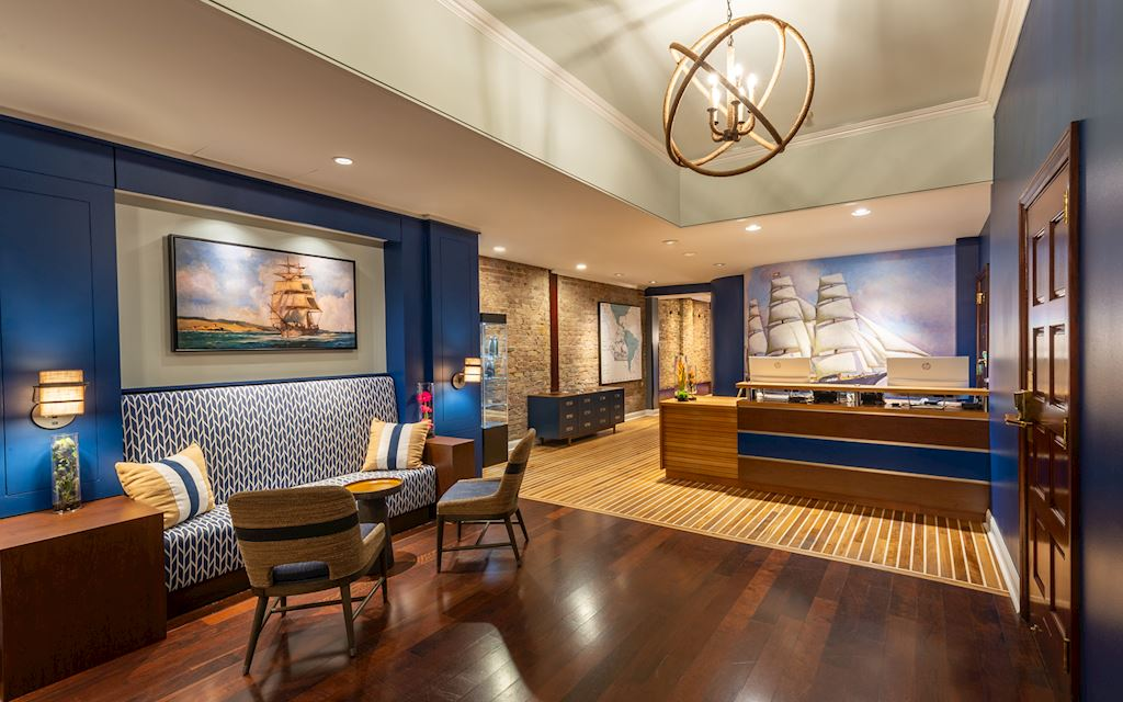 View of front desk and lobby with a nautical theme
