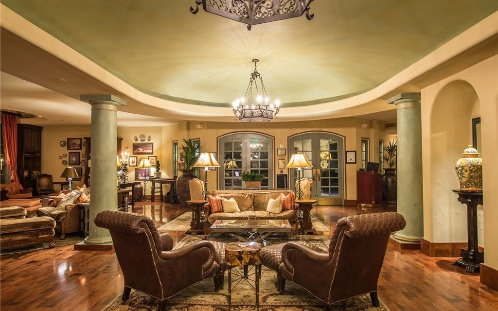 Indoor lobby with plush chairs and couches, rugs, and lamps